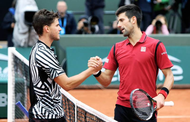 Dominic Thiem with his friend Novak Djokovic