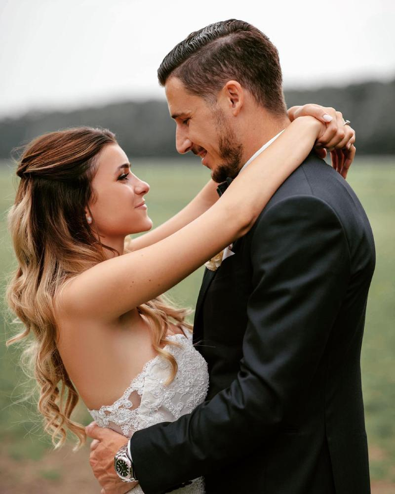 Mathew Leckie with his wife Laura Friese on their wedding