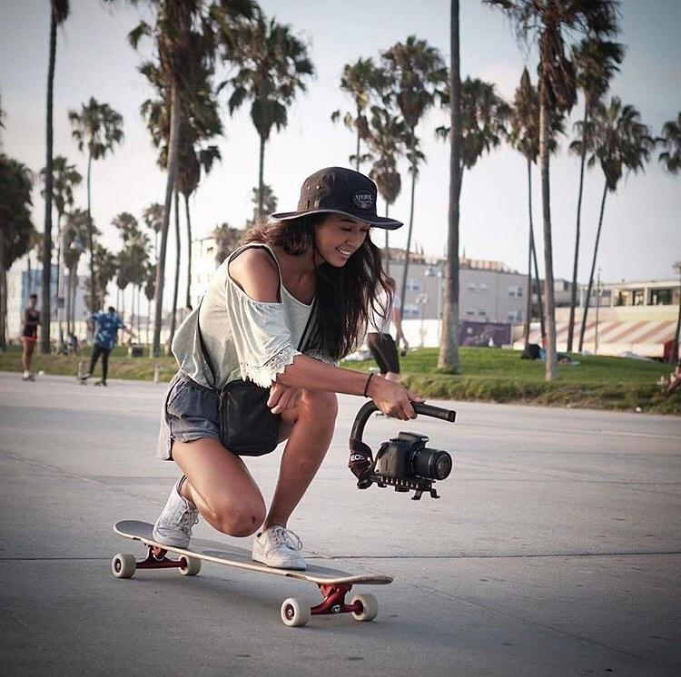 Natalie Pluto on her longboard/skateboard