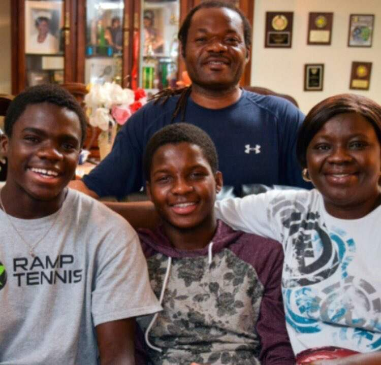 Frances Tiafoe with his parents and brother