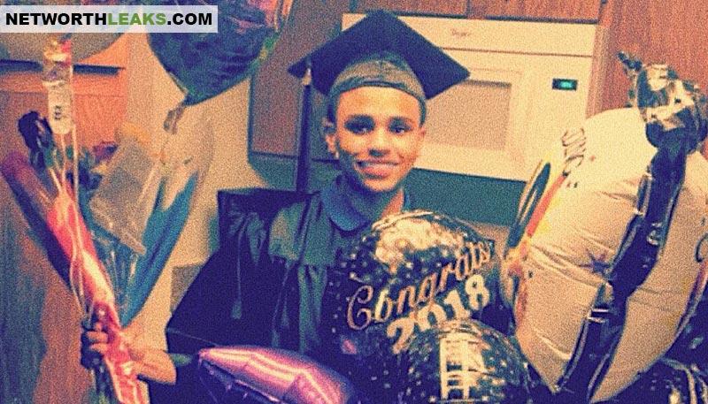 Malyk Santíago celebrating graduation in 2018