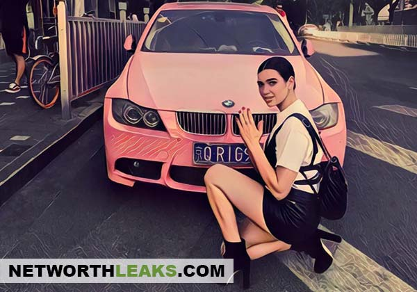 Dua Lipa next to a pink BMW