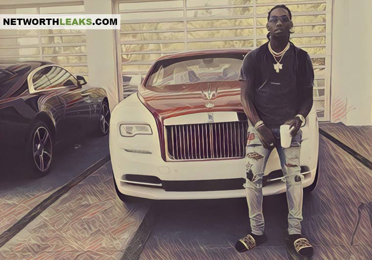 Offset (Migos) standing next to his Rolls Royce